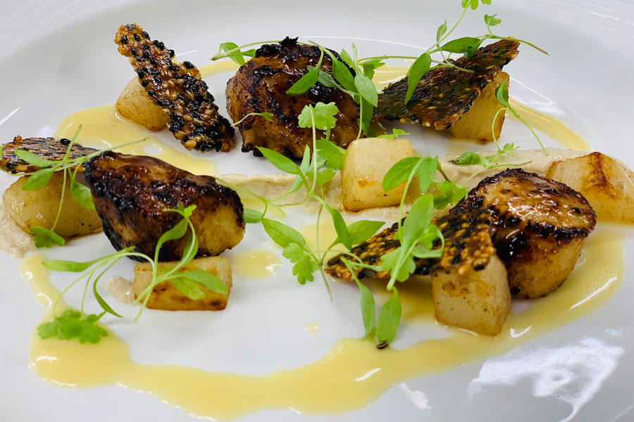 Seared scallops, miso glaze, sesame puree, turnip, and verjus cream