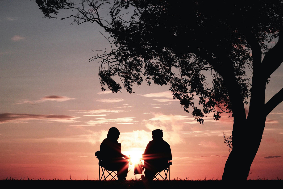 Shapes of two elderly couple in sunset